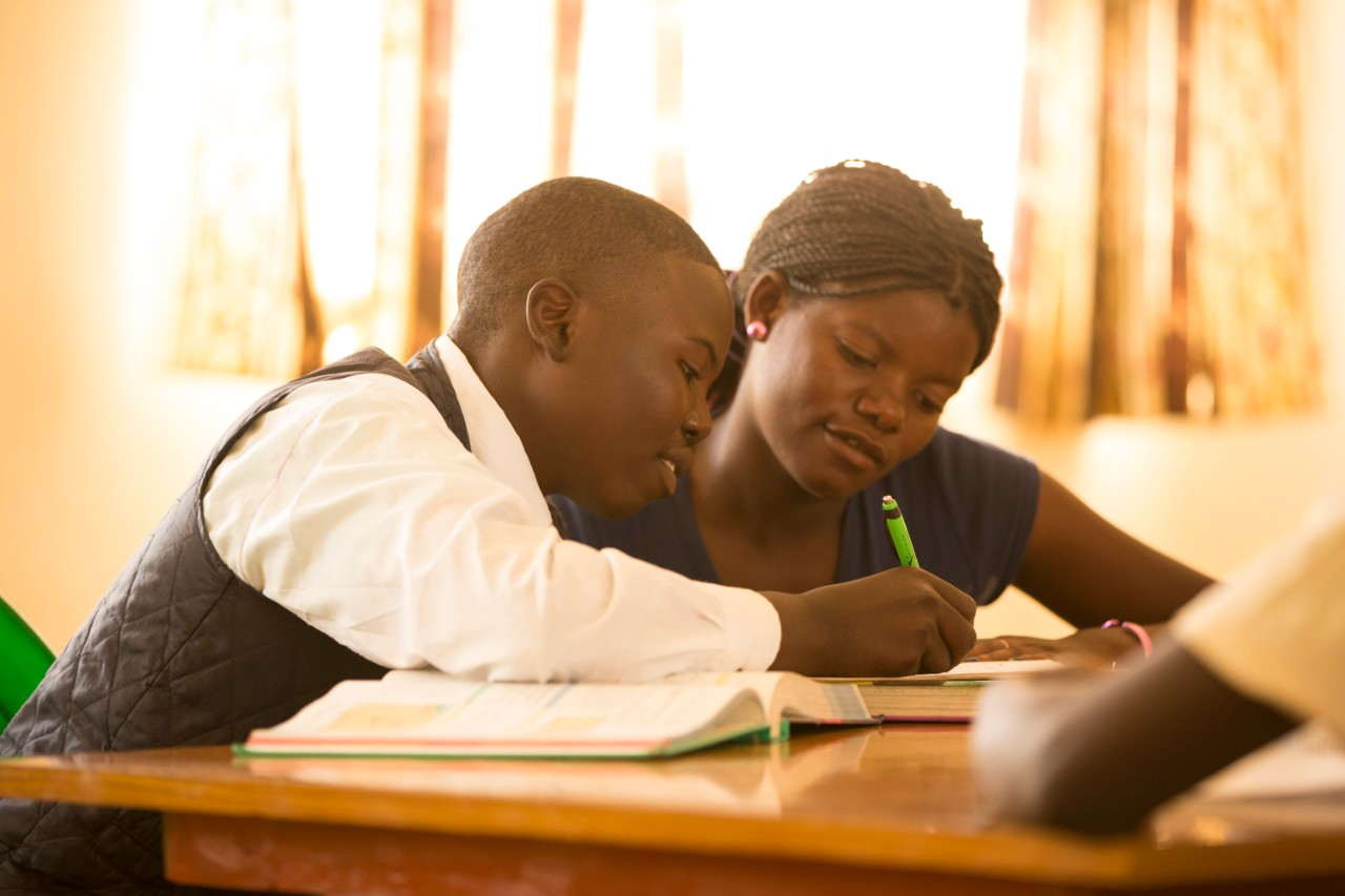 Malawi boy receiving education through the Educate the Children program